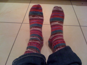 Me, sitting on the kitchen floor modeling my socks